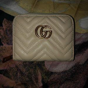 Gucci wallet.